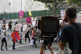 Man uses old camera to take pictures of protesters