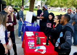 Students work at a table at the safety fair