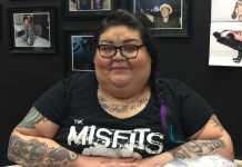 woman pictured at piercing shop