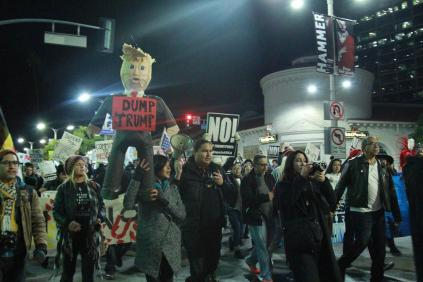 Protestors march in Westwood to protest Trump's decision to proceed with the construction of the Keystone XL and Dakota Access Pipeline on Tuesday.(Blaise Scemama)