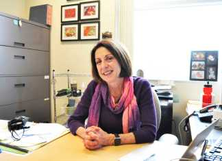 Pictured is Teri Lisagor sitting at her desk