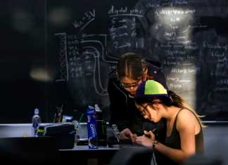 Photo shows two women studying together
