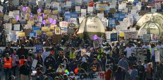 people protest in the streets of LA