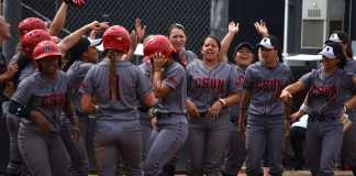 csun softball team celebrates after home run