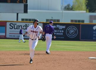 CSUN baseball player runs to third base