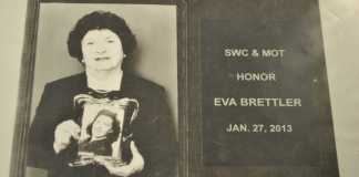 eva pictured holding a photograph of her mother