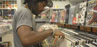 Thomas DaVinci pictured perusing the records in a record store