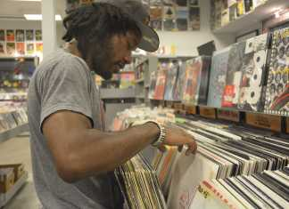 Thomas DaVinci pictured perusing the records in a record store