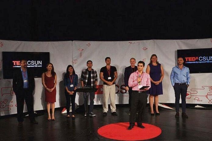 Lucas pictured on stage presenting for Ted x CSUN