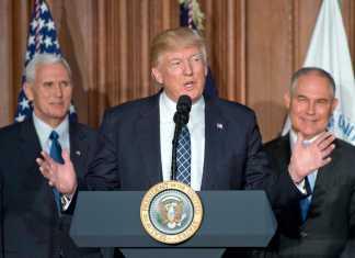 Donald Trump speaks at the podium