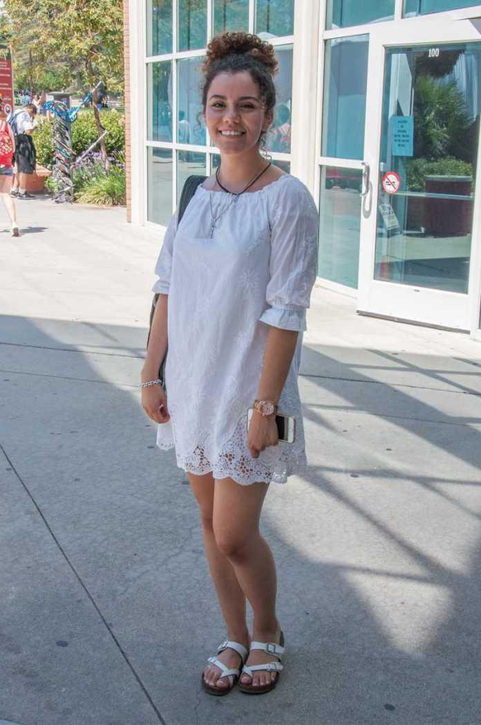 woman pictured wearing an all white dress