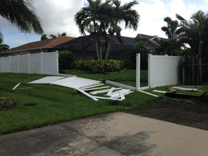 white fence knocked over on green grass