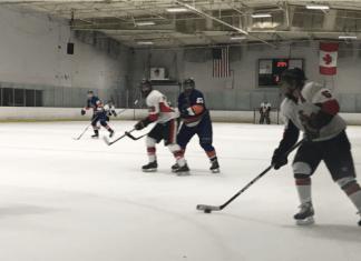 csun hockey team in white playing