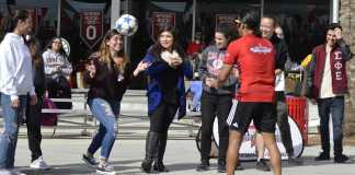 students participate in soccer game