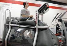 focused woman running on a treadmill