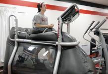 focused woman running on a treadmill