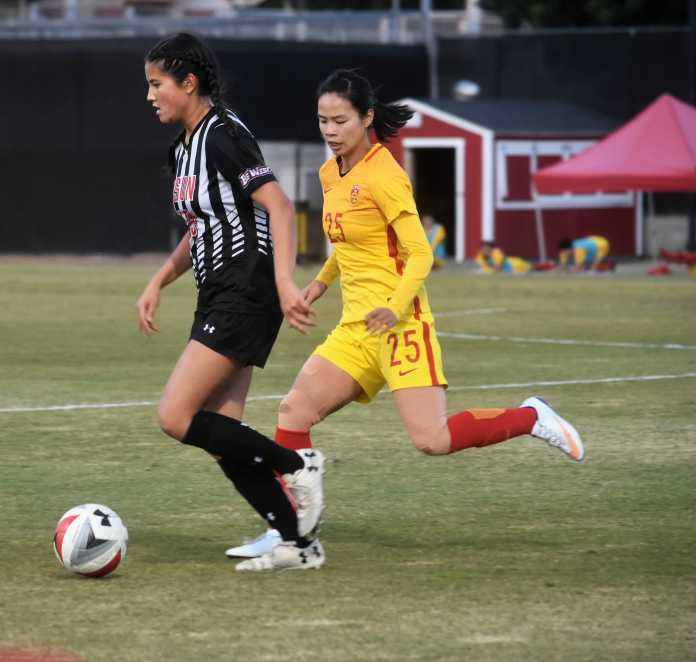 CSUN soccer player defending ball