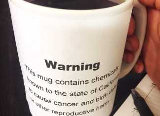 coffee mug with warning sign on it