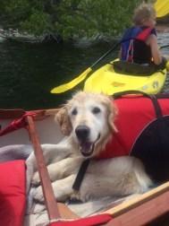 Seren riding in Kim's canoe