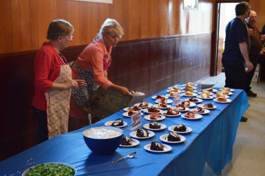Linda Eliuk and JoAnn Eliuk setting out the desserts
