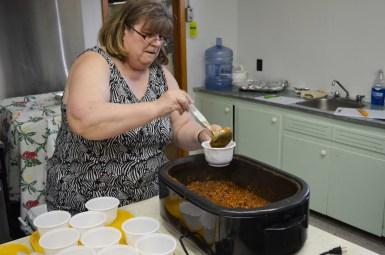 Bonnie Gushuliak preparing more chili