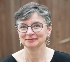 Poet Lisa Moore in her backyard in Austin, Texas