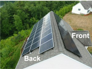 Black solar panel hides on a dark coloured roof.