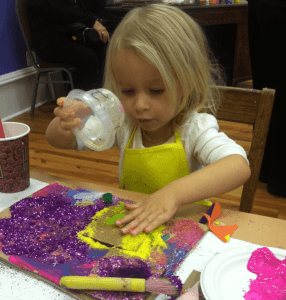 little girl doing art