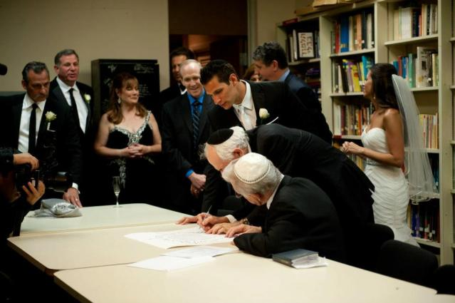 signing wedding ketubah