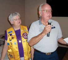 Sun Lakes Lions Club President Ruth Palmer looks on as Dave Mattson, representing the Sun Lakes Fire Department's Community Assistance Program, accepts a $200 donation for the CAP organization. Mattson thanked the Lions and highlighted how CAP works with the Fire Department to assist the residents of Sun Lakes in their time of need.