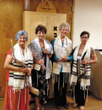 Four of the women blowing the shofar; pictured from left to right are Barbara Schwartz, Carolyn Cesario, Gloria Bitting and Gigi Stacy. Not pictured are Sydell Rochman-Pascale and Charlotte Currens.