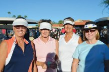 Tammy Visser, Sandy Worden, Joni Hiller and Nancy Gahn share a few moments of encouragement as they get ready to head out to their tee box.