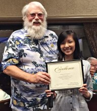 Roger Edmonds presents Uyen Hoang with a $500 check. Hoang was the winner of SLCT's first ever scholarship.