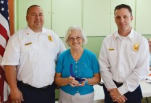 Sun Lakes Fire Department Chief Troy Maloney and Deputy Chief Robert Helie presented an award of gratitude to the Sun Lakes Women's Association President Colette McNally at the May meeting.