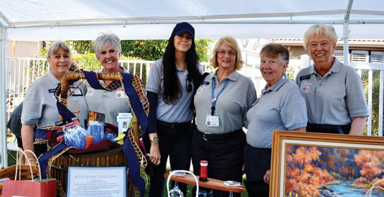 SLFD's volunteer Community Assistance Program members (left to right) Bobbie Rubin, Sheila Barton, Kristin Rose, Maureen Morrissey, Donna Quinn and Shirley Hutchings manned the raffle booth at Art at the Lakes which benefited the Sun Lakes Emergency Relief Fund administered by the Sun Lakes firefighters union. Photo by Brian Curry.