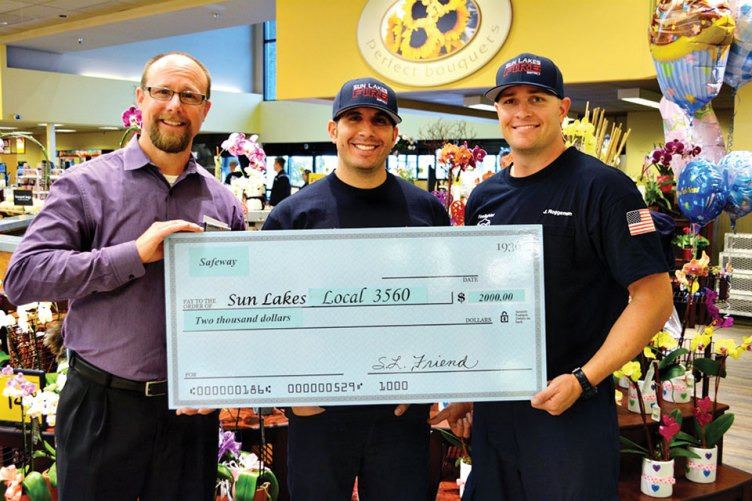 Pictured left to right are Safeway Manager Matt Clarke, Sun Lakes Fire District Captain Mike Molite and firefighter Justin Roggeman.
