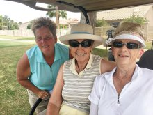 Beth Smith, Eleanor McCann and Carol Jones love the cool in the cart between shots.