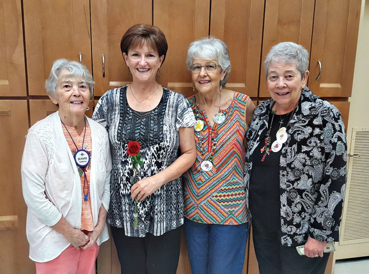 Debbie has reached her weight-loss goal. Left to right: Jeannie, Debbie, Dimple and Jeri are celebrating.
