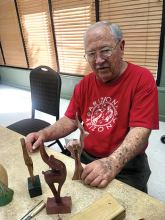 Wally Jasien has a very extensive kachina collection he has carved and is seen here with a new collection of graceful animal sculptures.