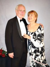 Emmett and Carmela Babler entering the San Tan Ballroom for the 25th Anniversary Black and White Ball that was held on January 12, 2019. Carmella acquired her gown in Spain while traveling. It really created a festive mood as she and Emmett entered the ballroom. Emmett and Carmela are longtime members of the club. Carmela has been instrumental in sharing her leadership skills with the club. Her practical ideas and commitment to our mission have been key to the transition to the Cottonwood venue.