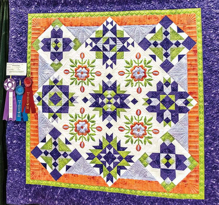 Diana Jones with winning quilt