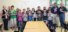 St. Bonaventure 3rd grade students holding dictionaries