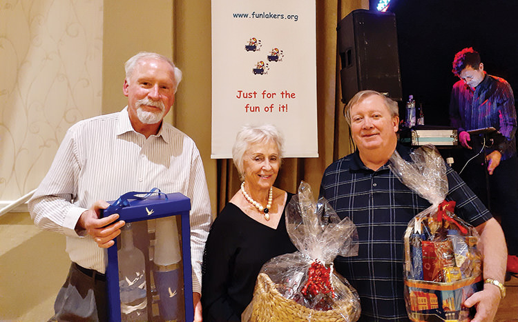 Door prize winners at the December Sun Lakes Dinner/Dance Party (left to right): Dave Cocco, Fran Stevenson, Peter Hanna