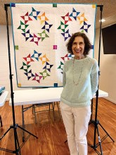 Pat Knoechel from the Quilt in a Day organization shared many quilts and tips, then taught a class showing how to create a table topper using curved borders.