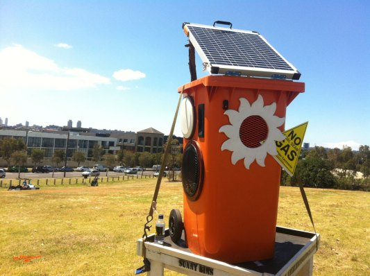 Orange bin sold to Auburn Girls High School being tested at a No Gas rally in Sydney Park, St Peters 2012