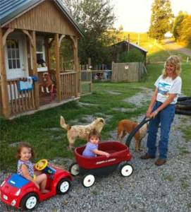 "Here I am playing with my granddaughters ""Alexis"" & ""Paige"". It didn't take them long at all to learn how to pull me around in my wagon!! :)"
