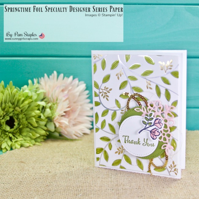 Handmade Thank You Card featuring a leaf pattern on a white background with silver foil outline. Gold Thread and Sequins layered behind a floral pink filagree and colored rose branch.