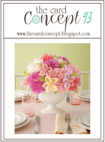 Floral centerpiece on a dinner table with soft, muted tones of Pinks, Yellows, Green and Purples.