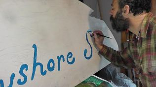Jacob working on sign