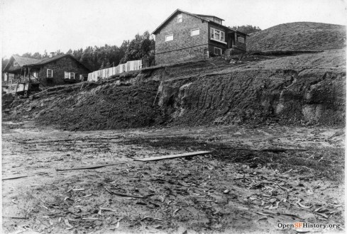 1915. The Mangels Slide. Looking northwest on the 600 Block of Mangels at Gennessee; house on left is 618 Mangels, on right 615 Gennessee. OpenSFHistory.org